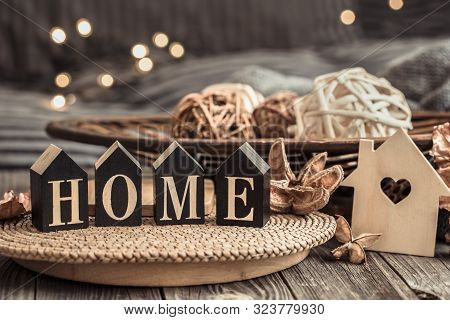 Still Life With Objects Of Festive Home Decor And Wooden Letters With The Inscription Home, Near A S
