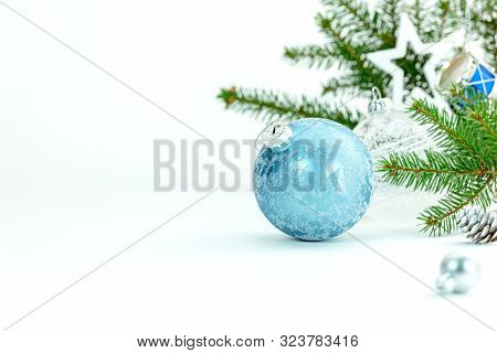 Festive White Background With Decorative Christmas Tree Balls And Green Fir Tree Branch