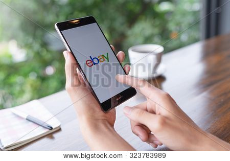Chiang Mai, Thailand - August 18,2018: Woman  Holding Huawei With Ebay Apps On The Screen. Ebay Is O