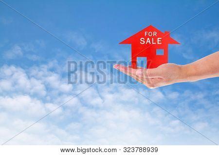 A Man Holding House On Sky Sale