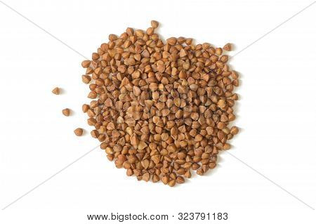 A Bunch Of Raw Buckwheat Grains On A White Background