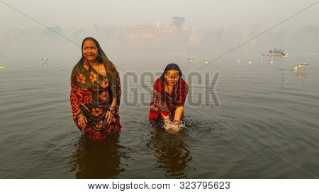 Women Bathing In Holly Ganga River And Pay Their Devotion Image Is Taken At Varanasi India On Jan 14