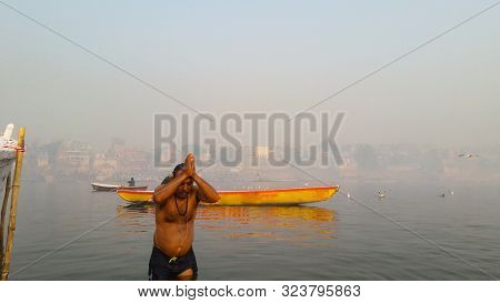 Man Bathing In Holly Ganga River And Pay Their Devotion Image Is Taken At Varanasi India On Jan 14 2