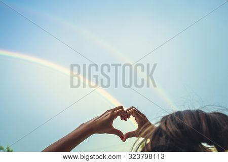 Symbolism Of Love, Rainbow Sky, Love. Heart Shaped Hands And Rainbow In The Sky. Double Rainbow.