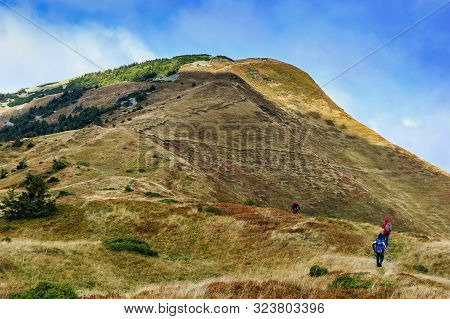 Tourists Climb To The Top Of Mount Strymba On A Beautiful Autumn Day Near The Village Of Kolochava,
