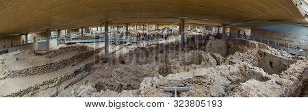 Santorini, Greece  - July 29 2019 Panorama Of Archaeological Site With Tourists Studying Remnants Of