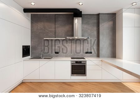 White Cupboard With Built In Household Appliance, Electric Stove, Oven, Sink On Worktop, Wooden Lami