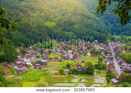poster of Landscape Traditional and Historical Japanese village Shirakawago in Gifu Prefecture Japan, Gokayama has been inscribed on the UNESCO World Heritage List due to its traditional Gassho-zukuri houses