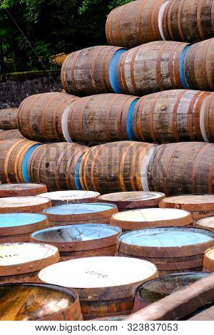 A Selection Of A Pile Of Traditional Wooden Barrels Used In The Distillery And Brewing Industries