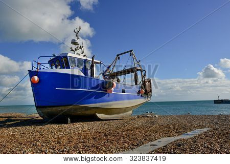 A Single Beached Fishing Boat On Single Beach