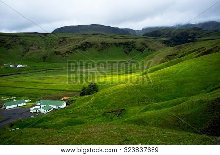 View Of Icelandic Landscape With Small Farm In Foreground