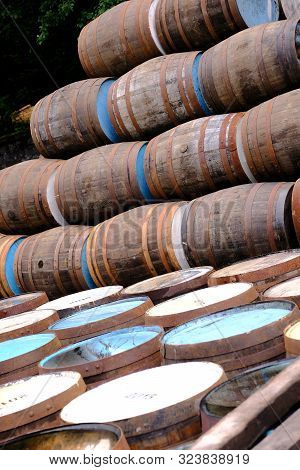 A Selection Of Wooden Barrels Used In The Distillery And Brewing Industry