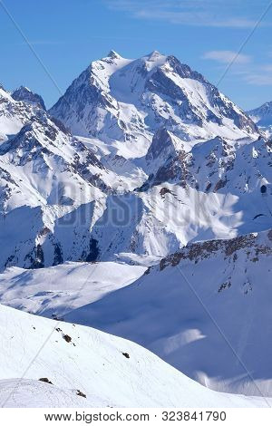 Snow Covered Mountain Peaks In The French Alps