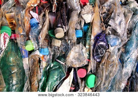 Plastic Bottles On Pile, Ready To Get Recycled. Recycling Of Old Plastic Bottles. Pile Of Packed And