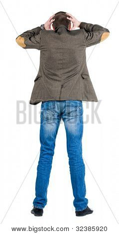 Back view of shocked business man in suit jacket .   upset young guy in jeans and  jacket. Rear view people collection.  backside view of person.  Isolated over white background.