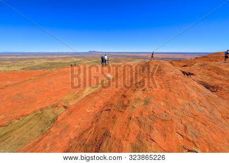 Uluru, Northern Territory, Australia - Aug 23, 2019: People Looking Mount Olga Rock Formation In The