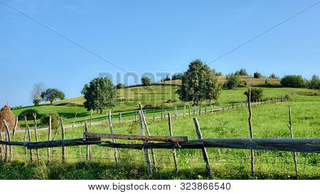typical countryside landscape of Transylvania with wooden fence, Romania