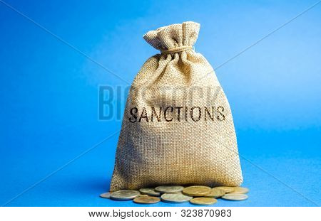 Money Bag With The Word Sanctions. The Imposition Of Economic And Political Sanctions On The Subject