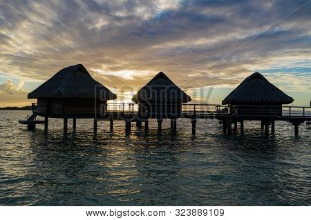 Luxury Overwater Villas During Sunrise And Otemanu Mountain At Bora Bora Island, Tahiti, French Poly