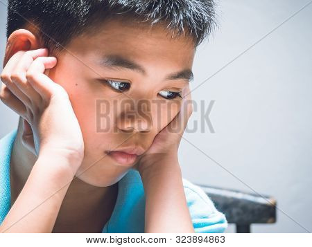 Sad Lonely Boy, Young Homeless Asian Child High Risk Of Being Depressed, Bullied And Abused. Miserab