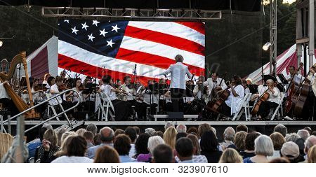 East Islip, Ny, Usa - 13 July 2019: The Long Island Concert Orchestra Performing For Free At Night U