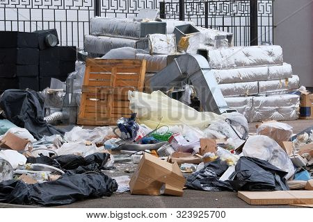 Construction Garbage, Cardboard, Polyethylene After Building Repair. Removal Of Debris. Bunch Of Tra