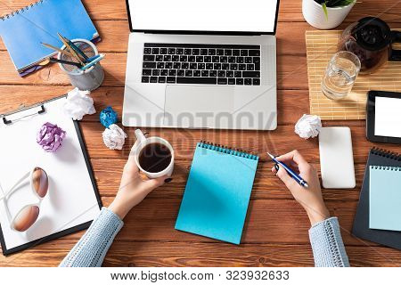 Business Woman Writing In Notebook At Office Desk. Online Business Learning And Education. Flat Lay