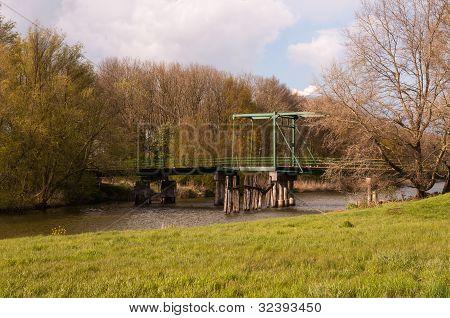 Historic Drawbridge In A Natural Landscape