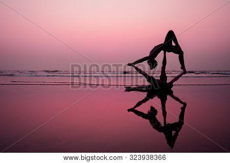 Muladhara Swadhisthana Manipula Tantra Yoga On The Beach Man And Woman Meditates Sitting On The Sand