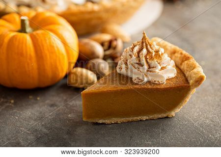 Traditional Pumpkin Pie Topped With Whipped Cream