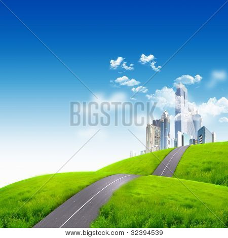 Modern city surrounded by nature landscape