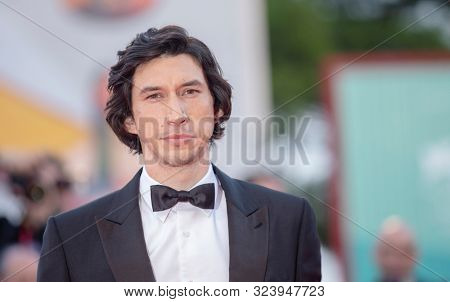 Adam Driver walks the red carpet ahead of the