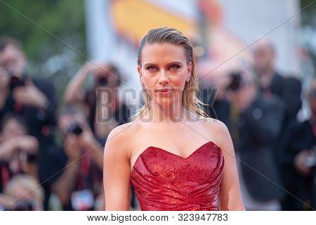 Scarlett Johansson walks the red carpet ahead of the