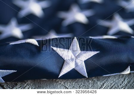 White Star On Textile American Flag Or United States Of America National Flag Background, Close Up.