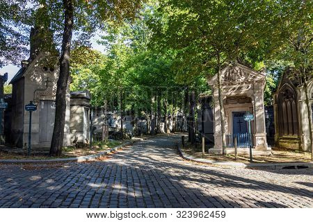 Paris, France - September 11 2019: Crossroad Of Alleys With Graves And Signs For Chapel And Cremator