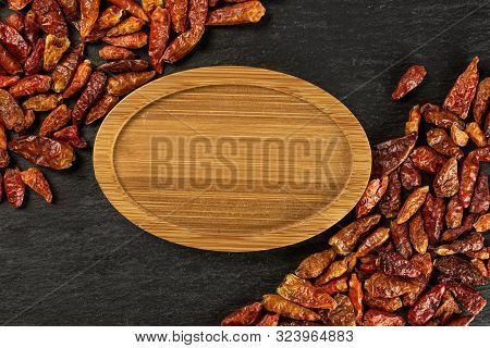 Lot Of Whole Dry Red Chili Pepper Peperoncino With Bamboo Plate Copyspace Middle Flatlay On Grey Sto
