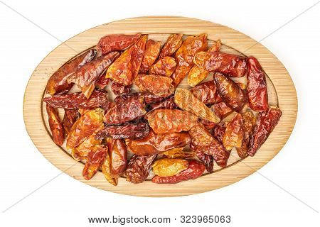 Lot Of Whole Dry Red Chili Pepper Peperoncino On Bamboo Plate Flatlay Isolated On White Background