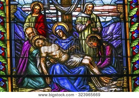Oaxaca, Mexico - January 5, 2019 Jesus Mary Cross Pieta Colorful Stained Glass Basilica Our Lady Of