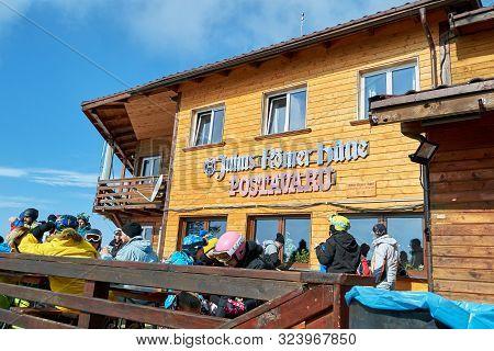 Poiana Brasov, Romania - February 20, 2019: Skiers And Tourists Having A Break At Julius Romer Hutte