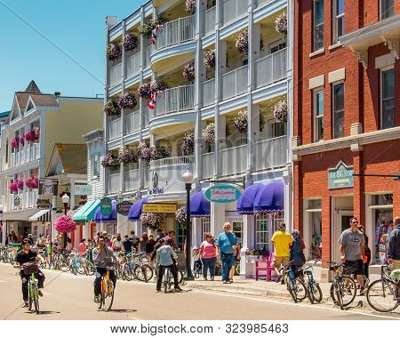 Mackinac Island Mi /usa - July 9th 2016: Bicyclists Cruising Along The Streets Of Downtown Mackinac