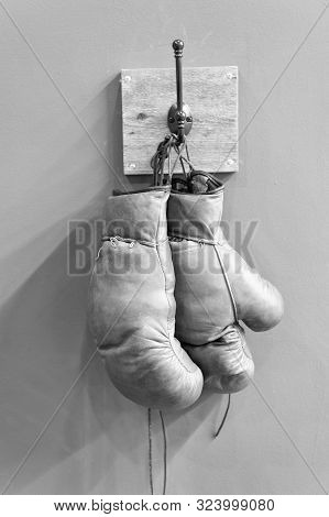 Retro Boxing Gloves. Vintage Sport Equipment. Boxing Concept. Old Boxing Gloves On Hanger. History O