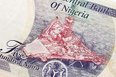 Part of Nigerian currency with oil platform poster