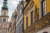 detail of tenement houses and town hall in old town of city of Zamosc in Poland poster