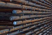 Industrial background. Rebar texture. Rusty rebar for concrete pouring. Steel reinforcement bars. Construction rebar steel work reinforcement. Closeup of Steel rebars. poster
