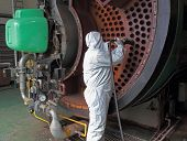 the cleaning of an industrial steam boiler poster