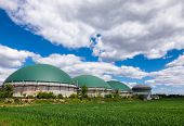 Anaerobic digesters or Biogas plant producing biogas from agricultural waste in rural Germany. Modern Biofuel Industry concept poster
