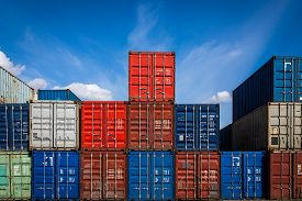 The Territory Of The Container Freight Yard:a Lot Of Metal Containers For Storing Goods Of Different