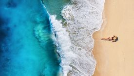 Aerial View Of A Girl On The Beach. Beach And Turquoise Water. Top View From Drone At Beach, Azure S