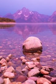 Rock On The Shore Line Of Jackson Lake At Sunrise In Colter Bay Village In Grand Teton National Park