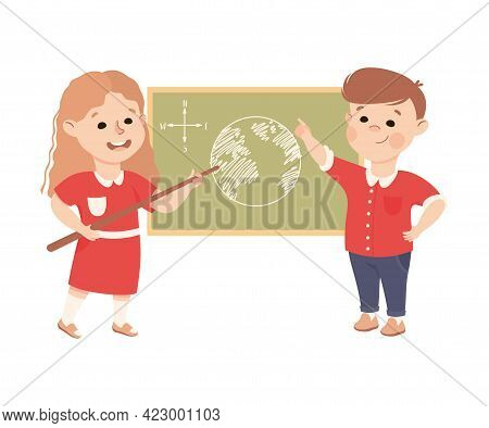 Cute Boy And Girl Having Geography Lesson, Elementary School Students Standing At Blackboard, Kids E